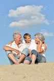 Boy with grandparents outdoor Stock Image