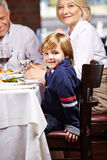 Boy with grandparents in restaurant Royalty Free Stock Images