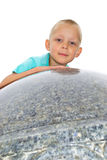 Boy on a granite bowl Stock Photos