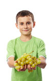 Boy with grapes Royalty Free Stock Photo