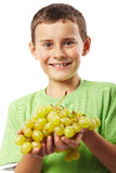 Boy with grapes Stock Photography