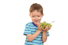 Boy and grapes Stock Images