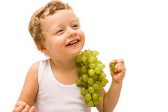 Boy with grapes Stock Image