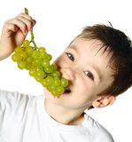 Boy with grapes Stock Photo