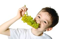 Boy with grapes Royalty Free Stock Images