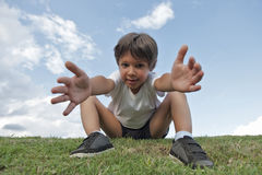 Boy on the grass Royalty Free Stock Photos