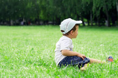 A boy on the grass Stock Photos