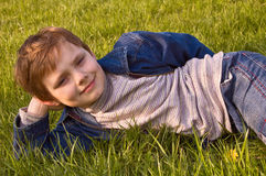 Boy on the grass. A cute boy lying on the grass Stock Photo