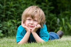 Boy on the grass Royalty Free Stock Image