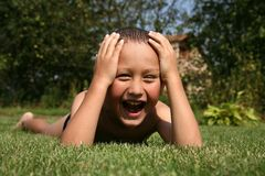 Boy in grass Stock Photos