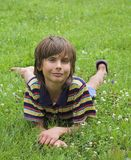 Boy on the grass. Boy on the green grass on summer Stock Photos