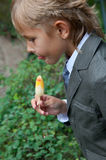 Boy in a gray suit eats ice cream Royalty Free Stock Images