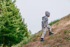 The boy climbs the mountain royalty free stock photo