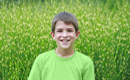 Boy in Green Stock Images