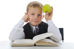 Boy with green apple Royalty Free Stock Photography