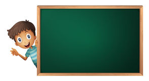 A boy and a green board Stock Images