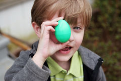 Boy with a green Easter egg Royalty Free Stock Photo