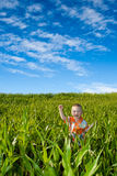 Boy on green field Royalty Free Stock Photography