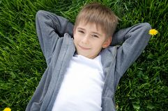 Boy on the green grass Royalty Free Stock Images