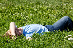 Boy in green grass. Royalty Free Stock Images