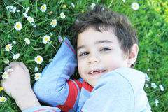 Boy  on the green grass. Happy child  on the green grass Stock Image