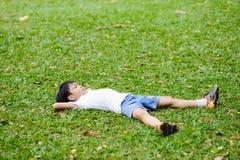 Boy on the green lawn Stock Photos