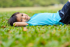 Boy on the green lawn Royalty Free Stock Photo