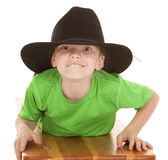 Boy green shirt cowboy hat lay looking Royalty Free Stock Image