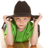 Boy green shirt cowboy hat look serious lay Royalty Free Stock Photography