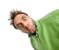 Boy with green shirt with surprised expression WOW. Stock Photos