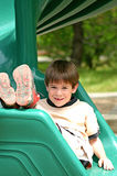 Boy on Green Slide Stock Photo