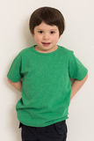 Boy in green t-shirt stock image