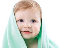 Boy in a green towel on white Royalty Free Stock Images