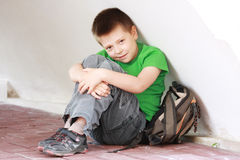 Boy in green under wall Stock Photography