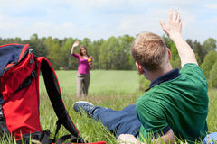 Boy greeting girl on a meadow Royalty Free Stock Image