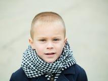 Boy on grey background. Royalty Free Stock Photos