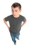 Boy in grey t-shirt and blue jeans Royalty Free Stock Photo