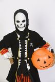 Boy In Grim Reaper's Outfit With Pumpkin Bucket Stock Image