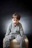 Boy grimace Stock Image