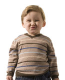 The boy grimaces Royalty Free Stock Photo