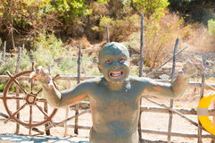 Boy grimaces in mud bath Royalty Free Stock Photography
