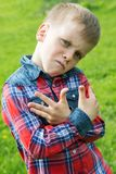 The boy grimaces in the style of rap Royalty Free Stock Photos