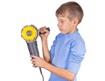 Boy with a grinder. Isolated on white background Royalty Free Stock Photo