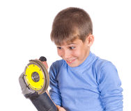 Boy with a grinder Stock Photography