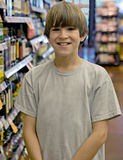 Boy at the Grocery Store Royalty Free Stock Photo