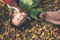 Boy on ground asking embrace Royalty Free Stock Photo