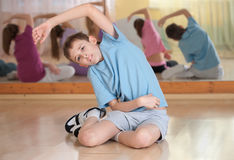 Boy and group engaged in physical training Royalty Free Stock Photo