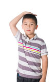 Boy growing tall and measuring himself, isolated on white backgr Royalty Free Stock Image