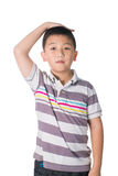 Boy growing tall and measuring himself, isolated on white backgr Royalty Free Stock Photos