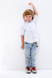 Boy growing up tall Royalty Free Stock Photo